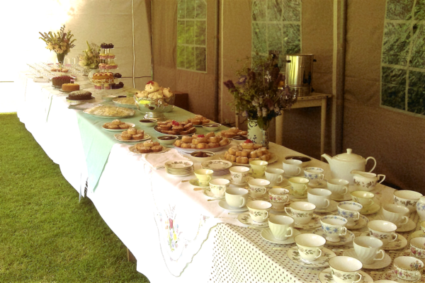 A table set up ready to serve tea and cakes at a wedding!