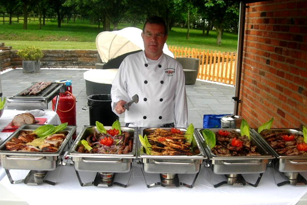 One of our chefs ready to begin serving the food!
