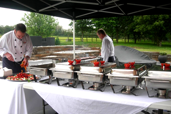 One of our chefs carefully constructing a platter before an event!